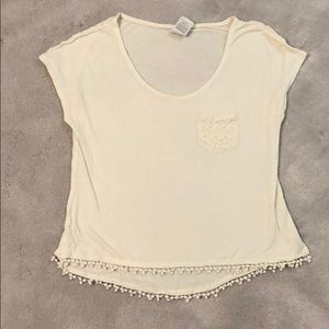 Super soft white top with lace pocket and poms